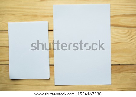Mock up white paper blanks on wooden background #1554167330
