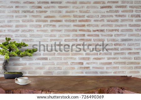Mock up wooden table with white brick wall. For product display montage.
