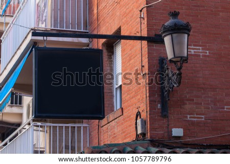 mock ups of restaurant street black signboards on yellow wall #1057789796