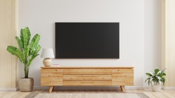 Mockup a TV wall mounted in a living room room with a white wall.3d rendering