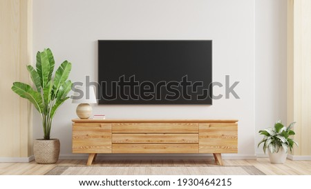 Mockup a TV wall mounted in a living room room with a white wall.3d rendering Stock photo ©