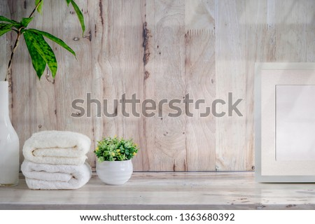 Mockup bath towels , blank wooden poster and houseplant on wooden table with copy space. Photo stock ©