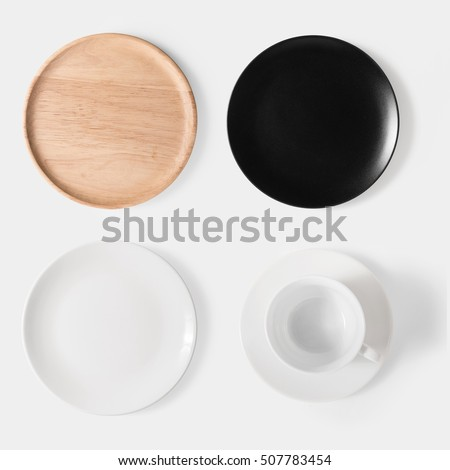 Mockup black dish, white dish, wooden plate and cup of coffee set isolated on white background. Copy space for text and logo. Clipping Path included on white background.