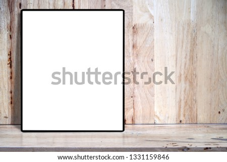 Mockup blank blank picture frame on wooden table with copyspace for product display. #1331159846
