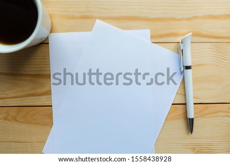 mockup blanks and coffee cup on wooden background #1558438928