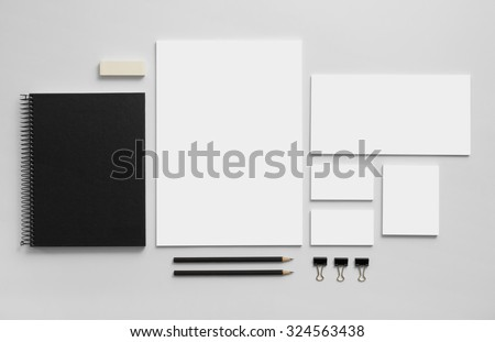 Mockup business brand template on gray background. Set of stationery with a black notepad.