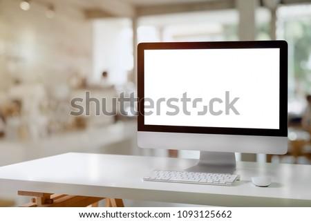 Mockup desktop blank screen computer on white wood table. #1093125662