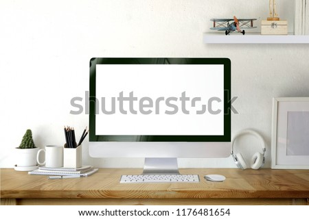 Mockup desktop computer on wooden desk. #1176481654