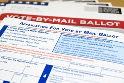 Mockup (fake / print-out concept) for election theme of Vote by Mail Ballot envelopes and application letter / form to vote by mail for election.
