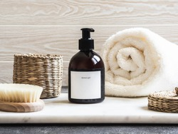 Mockup for bathing products in the bathroom, spa shampoo, shower gel, liquid soap with a towel beside and various accessories