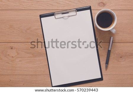 Mockup for check list, empty note pad paper with pen and coffee cup on brown wood background. Office, writer or study concept #570239443