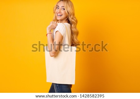 Mockup For Design. Millennial Woman With Cotton Bag Over Yellow Background