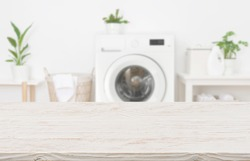 Mockup for design of empty wooden table in laundry room