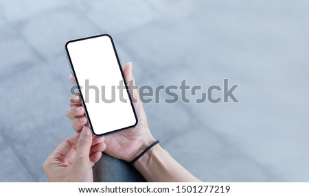 Mockup image blank white screen cell phone.woman hand holding texting using mobile at outdoor in  the city. background empty space for advertise text. contact business,people communication,technology  #1501277219
