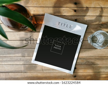 Mockup image magazine book and paths at the local wooden table in the coffee shop Stock photo ©