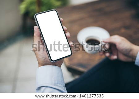 Mockup image man hand holding texting using mobile,cell phone with copy space,white blank screen for text.concept for contact business,people communication,technology electronic device #1401277535
