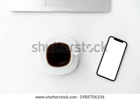 Mockup image of mobile phone with blank white screen, laptop and coffee cup with coffe on white background. Flat lay, top view modern minimalist blog header template. #1488706106