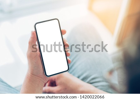 Mockup image screen cell phone.men hand holding texting using mobile at sofa.with copy space,white blank screen for text.concept for contact business,people communication,technology electronic device #1420022066