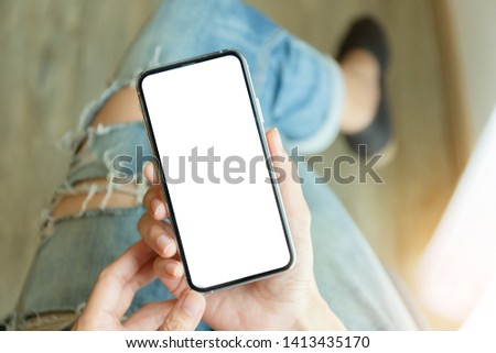 Mockup image screen cell phone.women hand holding texting using mobile with copy space,white blank screen for text.concept for contact business,people communication,technology electronic device #1413435170