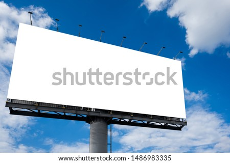 Photo of  Mockup Large white blank billboard or white promotion poster displayed on the outdoor against the blue sky background. Promotion information for marketing announcements and details