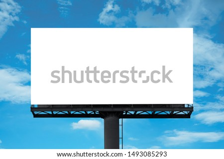 Mockup Large white blank billboard or white promotion poster displayed on the outdoor against the blue sky background. Promotion information for marketing announcements and details