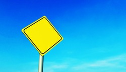 Mockup of a yellow diamond-shaped road sign on a metal pole, against a blue sky