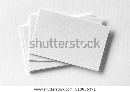 Mockup of business cards fan stack at white textured paper background. #518856391