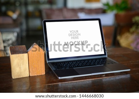 Mockup of business man using laptop screen for your advertising text message Laptop with blank screen on table compute work #1446668030