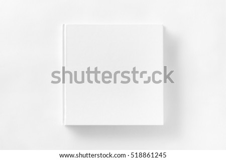 Mockup of closed blank square book at white textured paper background. #518861245