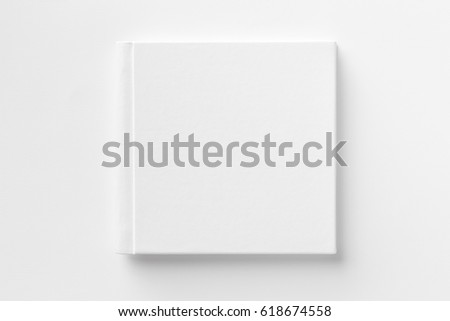 Mockup of closed blank square book at white textured paper background. #618674558