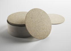 Mockup of empty blank beer drink cork coasters in studio environment on bright white background