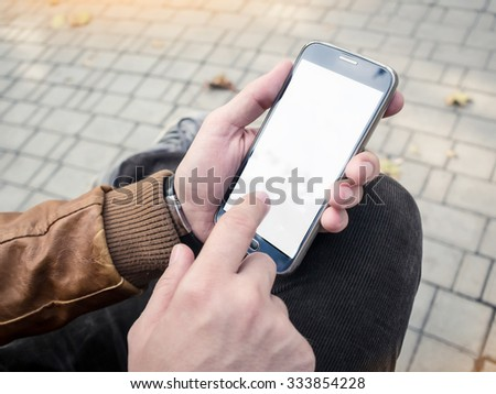 Mockup of mobile smartphone in man's hands #333854228