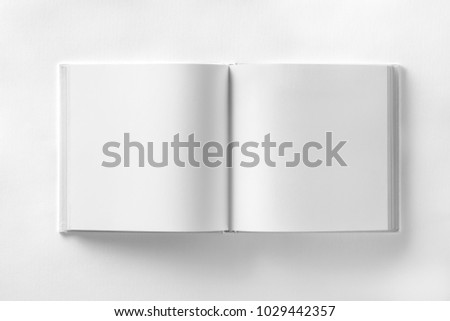 Mockup of opened blank square book at white design paper background. #1029442357