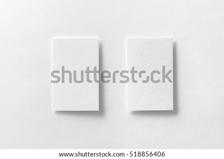Mockup of two vertical business cards at white textured paper background. #518856406