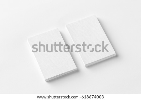 Mockup of two vertical business cards at white textured paper background. #618674003