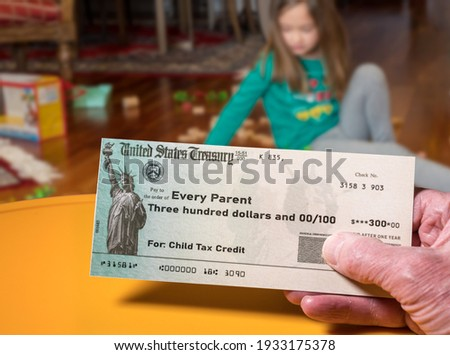 Mockup of US Treasury illustrative check for child tax credit for a small girl to illustrate American Rescue Plan Act of 2021 payments Сток-фото ©