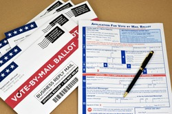 Mockup of Vote by Mail Ballot envelopes and application letter to vote by mail for election.