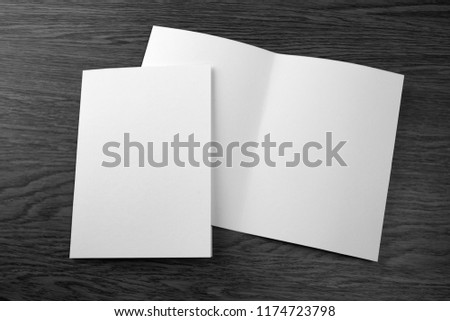 Mockup of white booklet on wooden background #1174723798