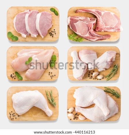 Mockup raw chicken and pork on cutting board set on  isolated on white background. Copy space for text and logo. Clipping Path included isolated on white background.