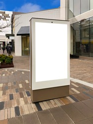 Mockup standalone big screen info kiosk. Digital media with blank white screen modern panel, display, signboard for advertisement design in a shopping center and mall. Including clipping path.