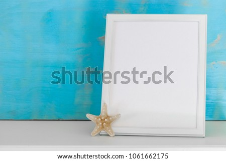 Mockup with white frame and star fish with a turquoise rustic background