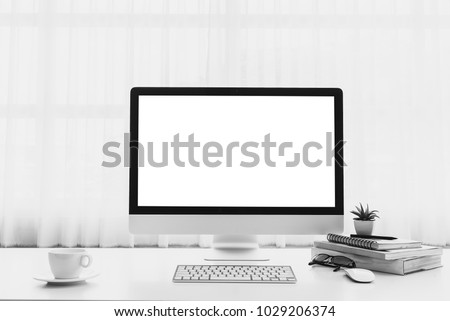 Mockup workspace with desktop blank screen computer on white table #1029206374