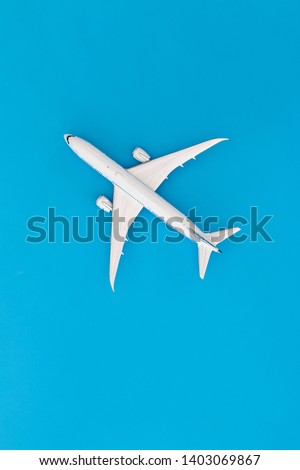Model airplane on blue pastel color background,Top view stock photo