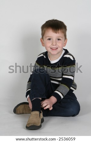 Model Boy Sitting And Smiling Stock Photo 2536059 : Shutterstock