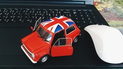 model car on the Keyboard. red Model car , red car open two door .