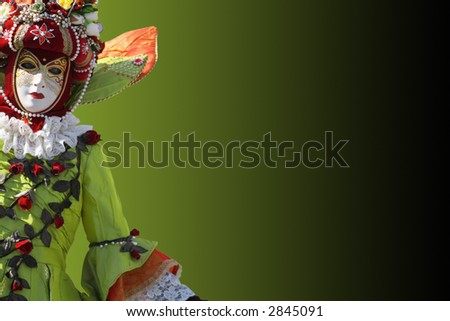 stock photography models. stock photo : Model dressed in a costume with a decorated venetian mask.