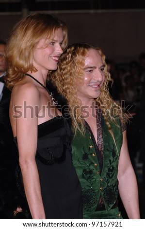 Model EVA HERZIGOVA & designer JOHN GALLIANO at the gala screening of Sin City at the 58th Annual Film Festival de Cannes. May 18, 2005 Cannes, France.  2005 Paul Smith / Featureflash