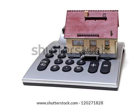 Model house and calculator isolated on white background