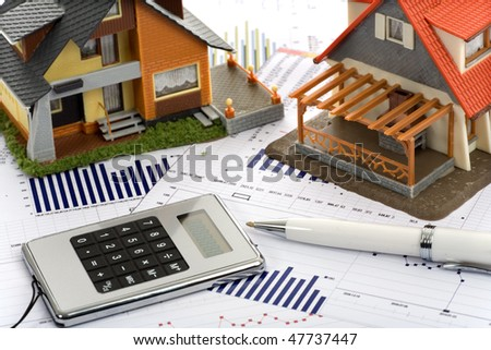Model House And Calculator On Construction Plan Stock