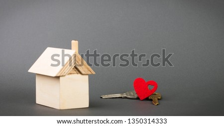 Model house on a gray background, the concept of mortgage #1350314333